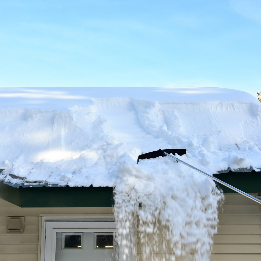 raking snow from roof