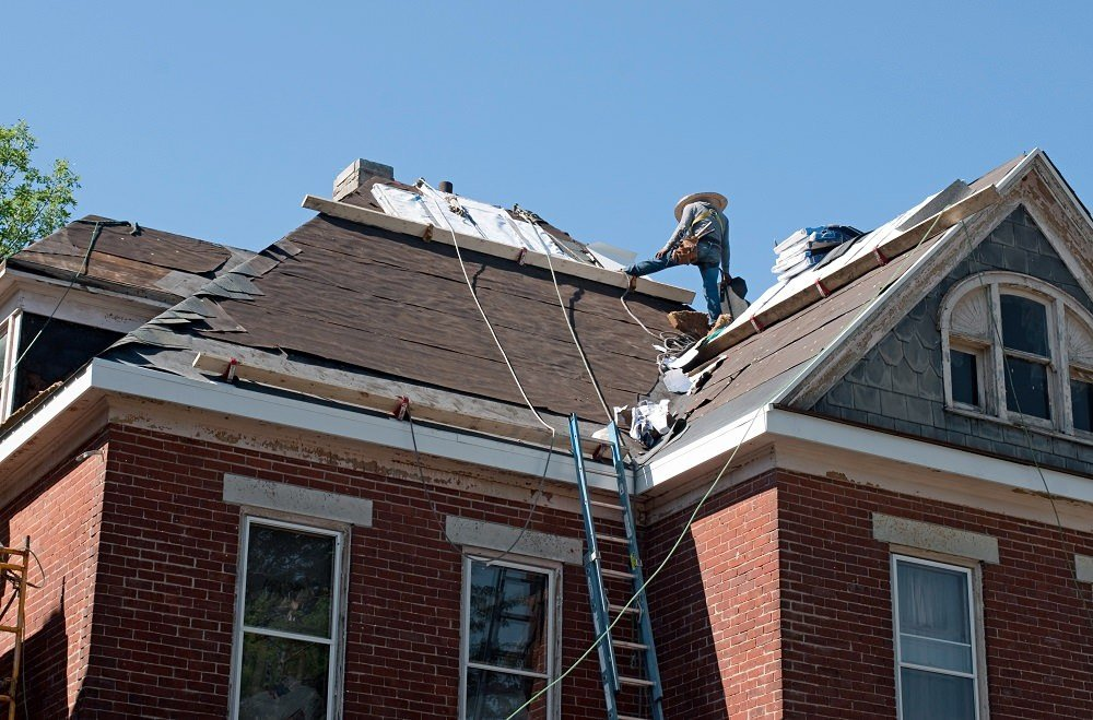 leaking roof being repaired in Acton MA