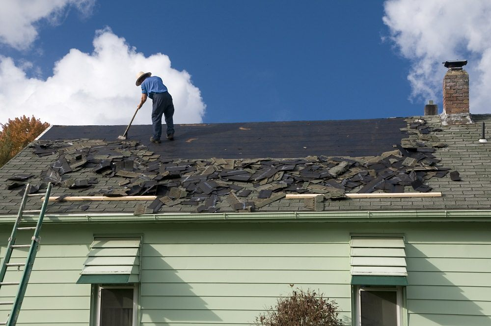 stripping shingles off a roof in Acton ma